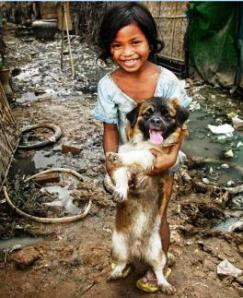 Girl in poverty India with dog